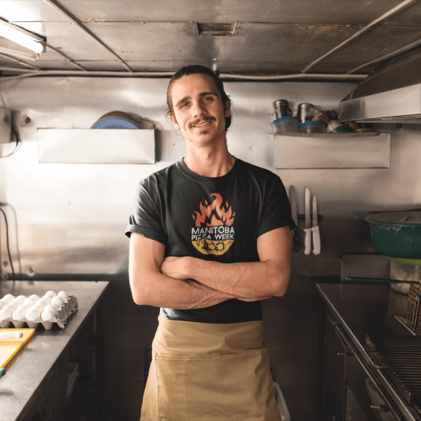 cook-wearing-a-t-shirt-mockup-and-an-apron-in-his-food-truck-a20301